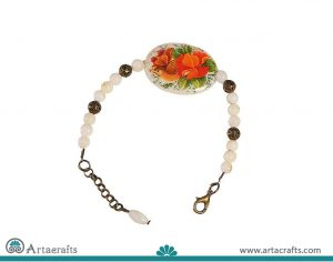 the seashell bracelet is an art and handicraft of Persia which is painted on it then covered with oil